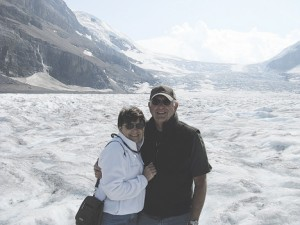 MAKING NEWS—Squire reporters Cliff and Nancy Hill freeze to get the story while standing on the Athabasca Glacier of the Columbia Icefields in Jasper National Park, Canada.