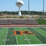 HISTORIC GAME—fans will se the varsity football players on the new Mondo turf field for the first time Thursday, September 3.