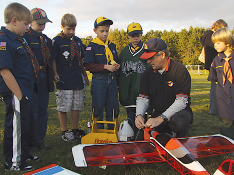 ACTION—Jerry Hough prepares his 540 Edge for flight as Scouts (l-r) Sean McLellan, Jake Carlson, Nate Triesenberg, Ethan Cowlbeck, Jack Montroy and Ian Henschell watch.