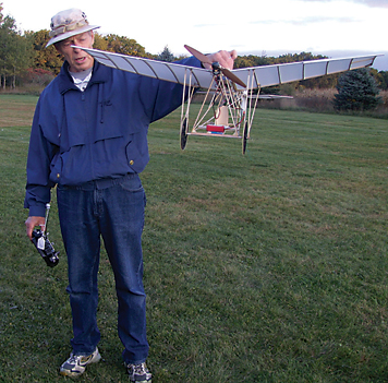A THING OF BEAUTY—Dave Hartley shows off his Demoiselle Model 1909 to the group.