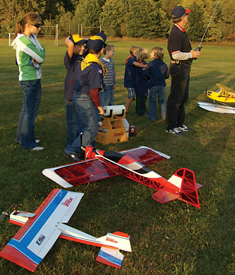 IN CONTROL—Jerry Hough works the controls as the Scouts check out the different planes on the display.
