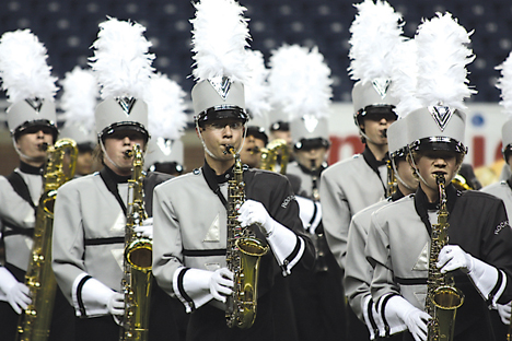 "Rockford High School's marching band scores 84.9 for their performance of ""The Four Freedoms"" at the MCBA state championship, earning them third place."