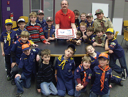 Pack committee chairman Guy McLellan and the Crestwood Cub Scouts celebrate the 100th year of Scouting in the USA.