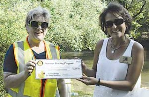 Rotarian Sue Bodenner presents a $2,200 check to Lisa Jacobs of Rockford Community Services for the Summer Reading Program.